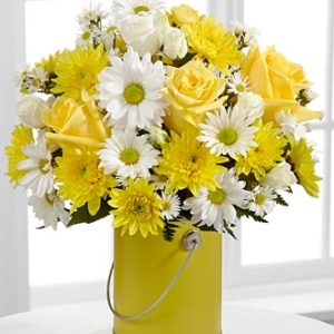 bouquet of yellow and white roses and daisies